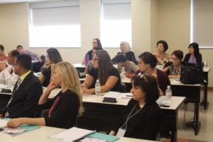 Attendees listen eagerly to the lecture on transcription